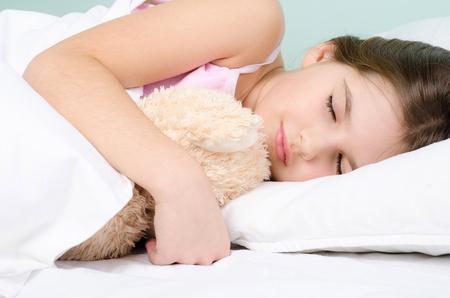 good night: little girl sleep with teddybear