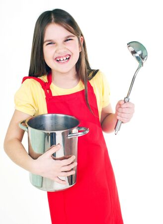 smile girl in red apron with a metal ladle and pan on white photo