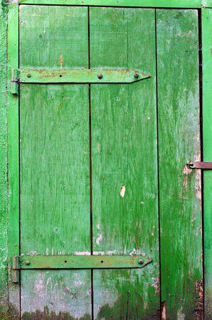 Old grungy wooden door texture Stock Photo - 22147005