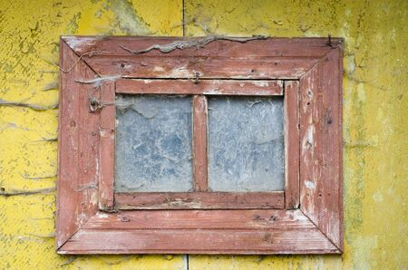 a old windown on wood wall Stock Photo - 22147012