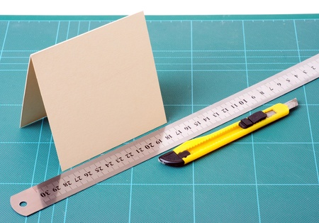 solver: knife, paper, and ruler on the cutting board Stock Photo