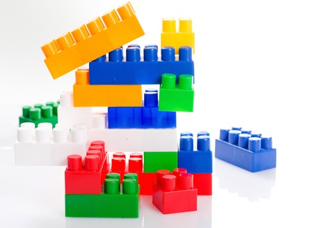 plastic toy blocks on white background photo