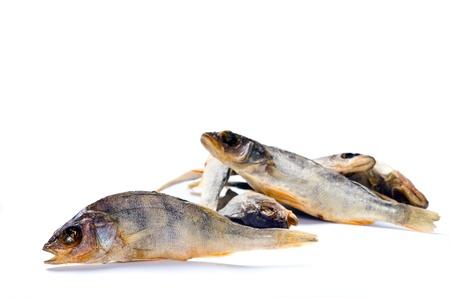 a group of dry fish on white background photo