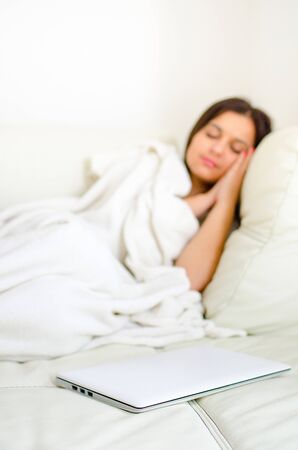counterpane: beauty girl with laptop lying in the bed Stock Photo