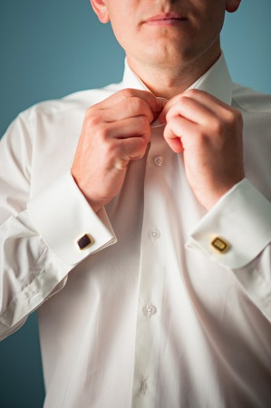 buttoning: young man button up shirt Stock Photo