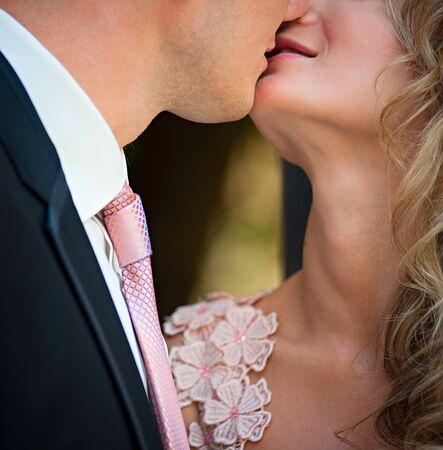 newlywed couple: a loving couple kisses