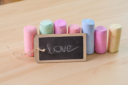 white chalks: colorful chalk on wooden board