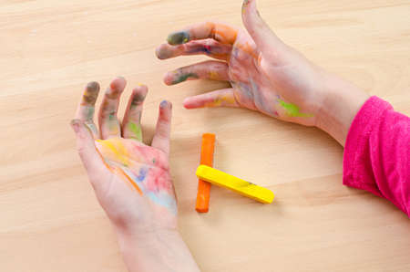 kids painted hands: chalk stained hands