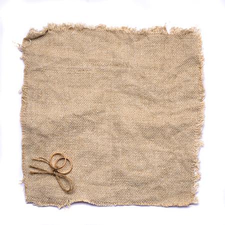 sacking: Two gold wedding rings lying on brown cloth sacking