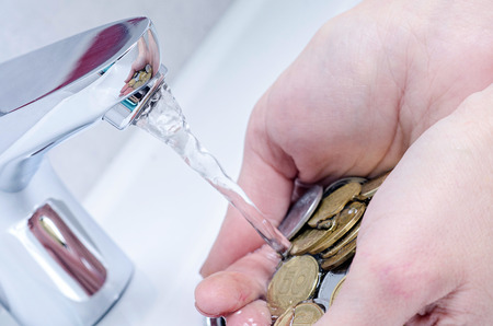 wash basin and running water from the tap in chrome bathroom, water saving concept Stock Photo