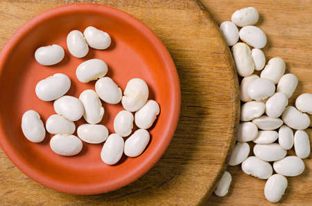lima beans white beans: big white beans in a clay plate on a wooden background
