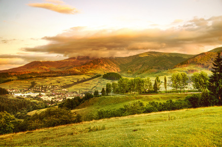 panoramics: sunset in small city in mountain