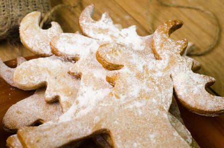 deer in heart: Christmas gingerbread deer cookie on wood backgound