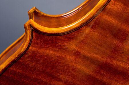 wooden violin part on black background, macro