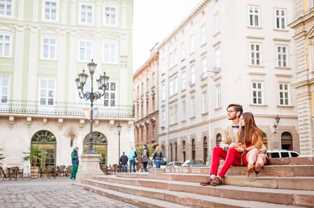 Young smile  couple sitting on stairs in summer photographs selfie Stock Photo
