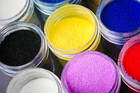 artistry: a lot of multicolored paint in jars for makeup artistry