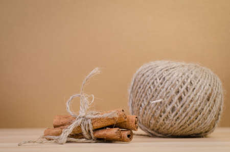 pack string: a group of cinnamon on the wood board,