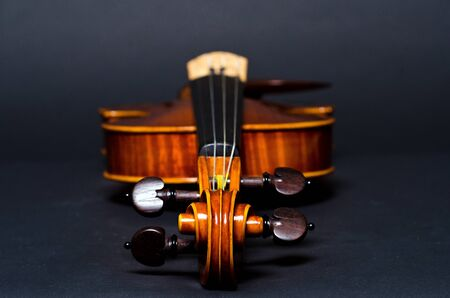 black carpet: view of old wooden violin on black background Stock Photo