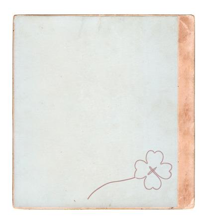 three leafed: old photoframe with shamrock , isolated on white