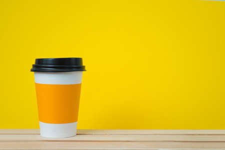 sleeve: Paper cup with Sleeve on yellow background Stock Photo