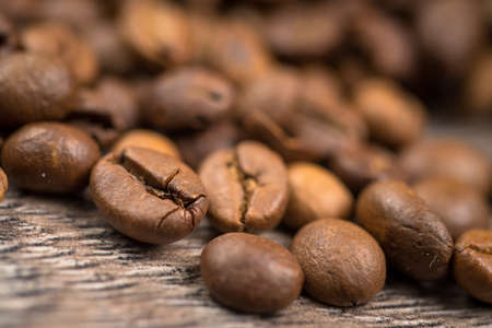 coffeetree: Black coffee on grunge brown wooden background Stock Photo