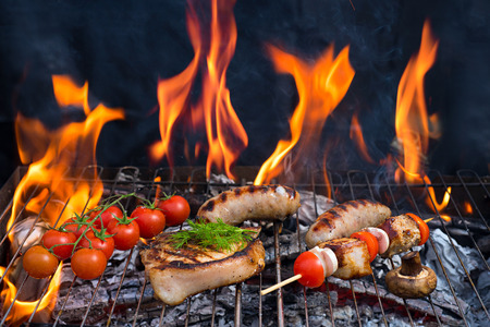 grill chicken: Assorted delicious grilled meat with vegetable over the  barbecue with fire