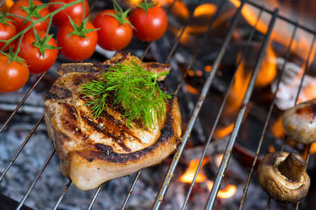 stake: Stake grill and tomatoes with flame on background