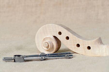 violin making: a making head of violin and wood texture Stock Photo