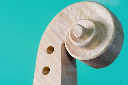 violin making: a making head of violin and wood texture Stock Photo