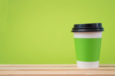 sleeve: Paper cup with Sleeve on green background