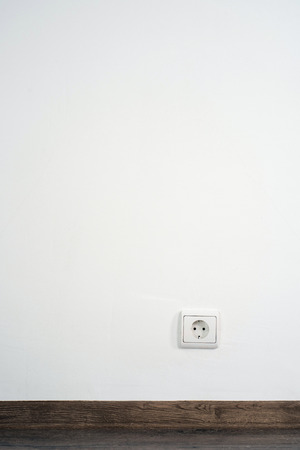 wood molding: electrical outlet on white wall. home design Stock Photo