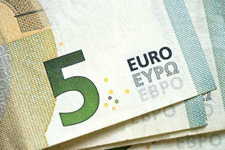 pack of dollars: stack of money a new 5 Euro