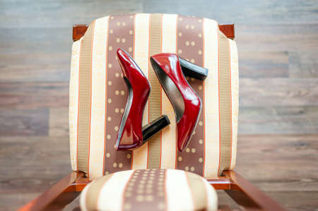 baroque room: Baroque chair and red womens shoes  in an empty room Stock Photo