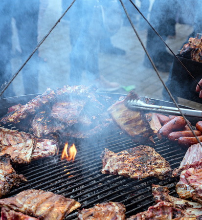 pork ribs: group of Grilled pork ribs on the grill. Stock Photo