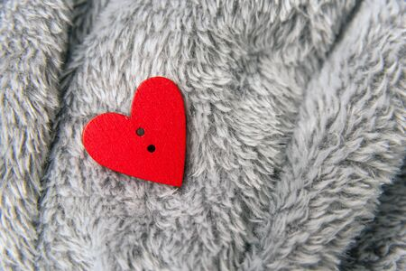bedspread: Valentines day red heart on bedspread Stock Photo