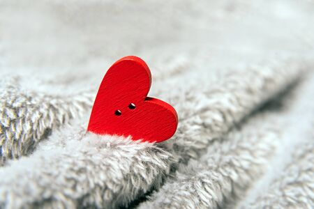 Valentines day red heart on bedspread.