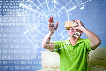 visualizing: Concept of virtual reality carton glasses and interfaces. young man in green t-shirt man enjoying vr glasses.