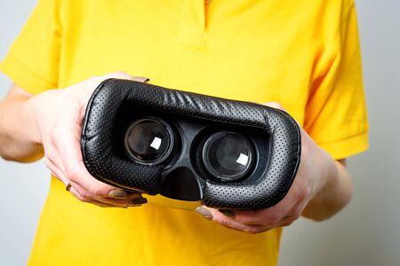 Virtual reality concept. Man or women holding VR glasses device in Hand Stock Photo