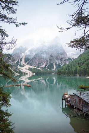 Braies lake and boats in mountain in Dolomites Stock Photo