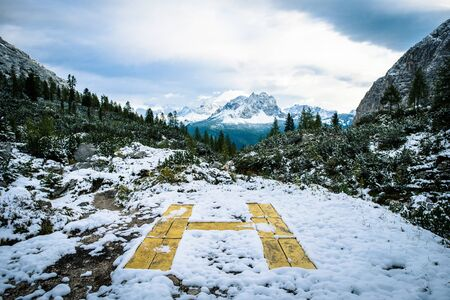 yellow helipad on the roof with mountain view