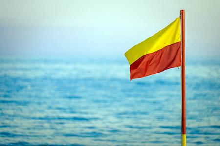 red and yellow life saving flag