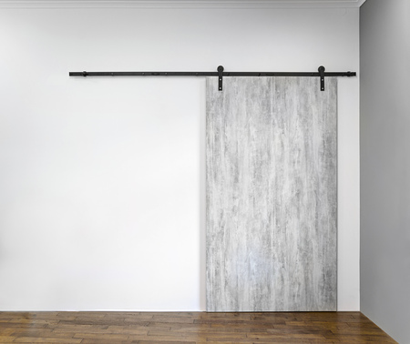 Modern sliding gray door on white wall