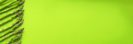 Texture of fresh green asparagus, top view. Stock Photo