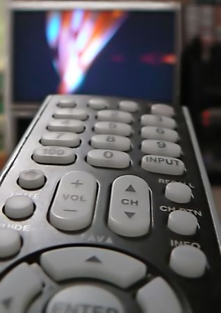 Remote control for home electronic devices with TV set in the background