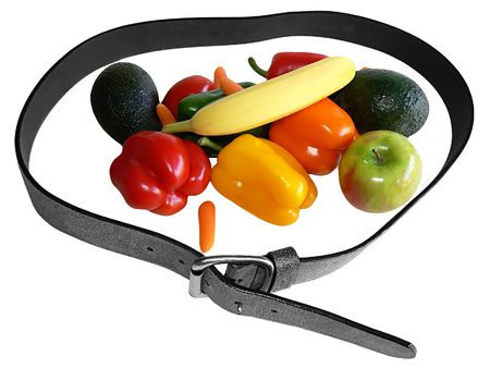 Fruit and vegetabel inside a belt symbolizing nitrition for a weight loss, isolated on white Stock Photo