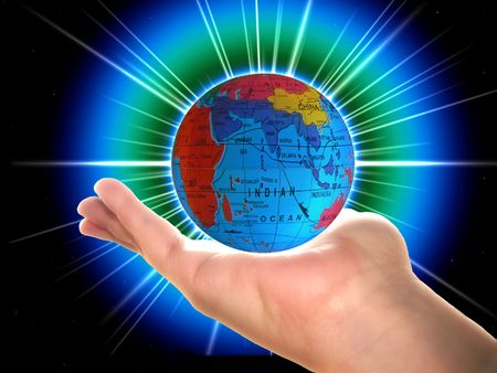 malaisia: Globe with destination ad for India or Indonesia in a womans hand Stock Photo