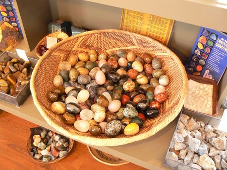 Collection of gemstones on a store showcase with descriptive booklets 写真素材