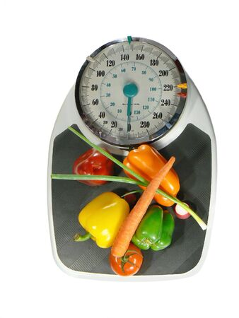 vegetables on a weight scale, symbolizing diet choices for a healthy lifestyle Stock Photo - 888377