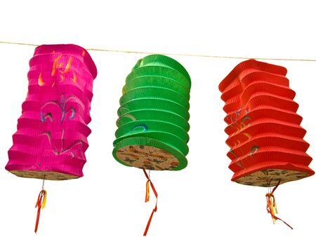 colorful lantern: Three Chinese paper lanterns hovering in the wind, over white