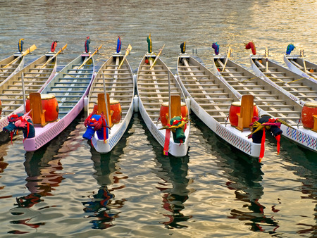 basking: Dragon boats basking in a warm sunlight before the race Stock Photo